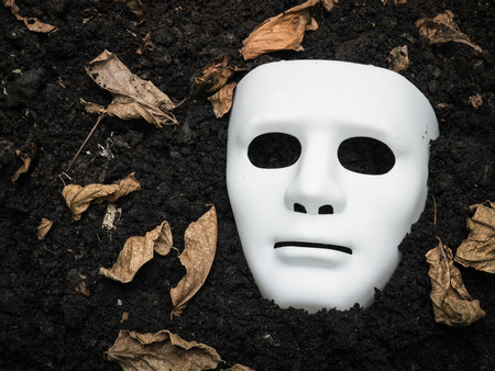 ghost mask: White Scary Halloween mask on the ground
