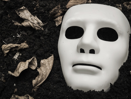 halloween mask: White Scary Halloween mask on the ground