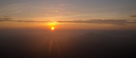 winter sunrise: Landscape of sunrise flare lighting and mountain at Phu ruea national park, Loei -Thailand