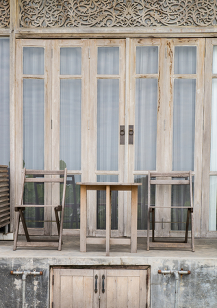 antique chair: antique wooden table and chair in front of wooden door