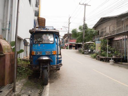 simple life: CHIANG KHAN,LOEI,THAILANDOCTOBER13,2015:Vintage motor tricycle at Chaing Khan.The town is quiet with simple life style of people. It is a very nice place for relaxation and let your mind fly with local life. Editorial