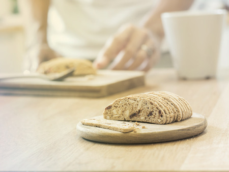 almond biscuit: Slice almond  biscuit cookie on wooden tray ( Vintage tone color ) Stock Photo