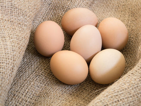 sackcloth: Fresh farm eggs on sackcloth Stock Photo
