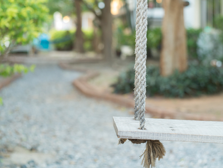 play the old park: Wooden swing in the garden
