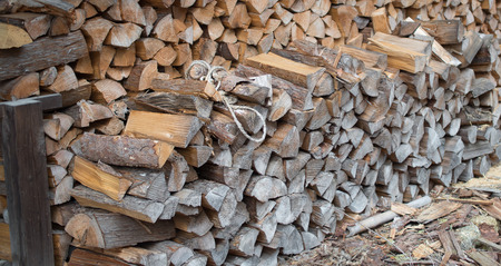 chock: Dry chopped firewood logs in a pile Stock Photo