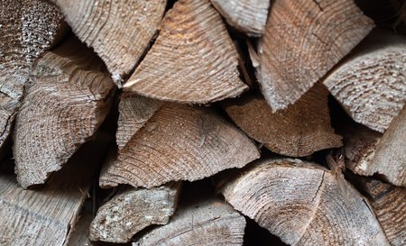 chock: Close up Dry chopped firewood logs in a pile
