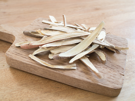 liquorice: dried liquorice roots on wooden tray Stock Photo