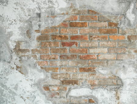 Background texture of aged cracked concrete and brick wall Фото со стока
