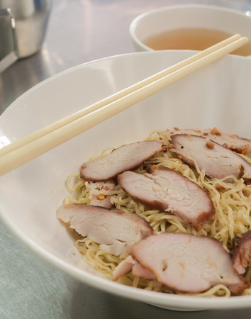 noodle with pork in white bowl ( Thai food style )