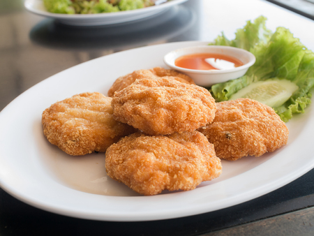 fried fish patty( fried fish-paste balls ) on white plate, Thai food style
