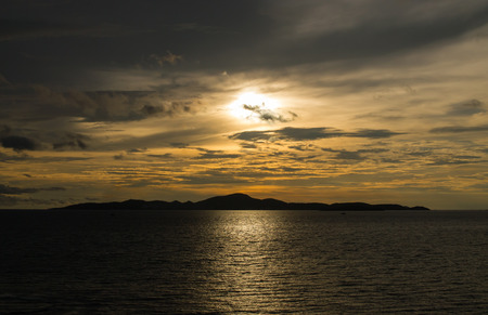 Landscape of silhouette island and the sea in sunset at Pattaya,Thailand