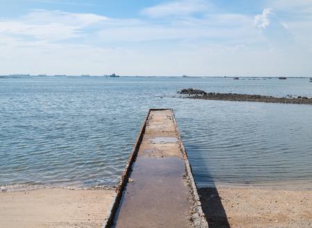 Stone brick jetty to the sea Фото со стока