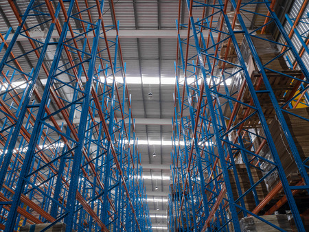 construction of blue and red shelf in warehouse