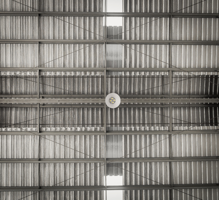 Industrial building warehouse ceiling lamp , show roof structure ( Hight contrast and grain tone )