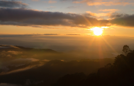 Landscape of  sunrise and moving mist in the mountain and hill . View sunrise  point of mountain at Doi-Montngo, Chiang Mai �Thailand Stock Photo