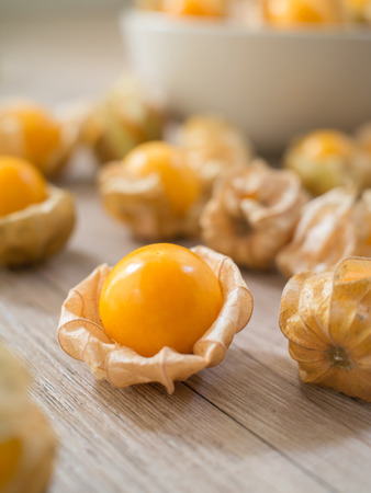 Fresh Cape gooseberry on wooden background