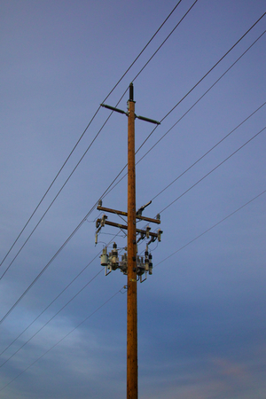 power pole: Pole and Power lines with blue background and clouds