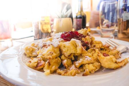 Kaiserschmarrn - traditional austrian pancake dessert served in a restaurant