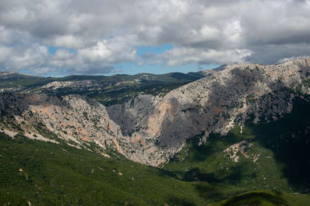 Gola di Gorropu. Famous and impressive gorge in the mountains of Sardegna, Italy. Hiking national park. panoramic shot. Banco de Imagens