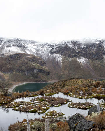 Lagoon located in the Los Nevados National Natural Park in Colombia, with a background of rocks and ice