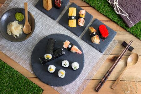 Sushi Meal on Wooden Table with book Stock Photo - 129441014