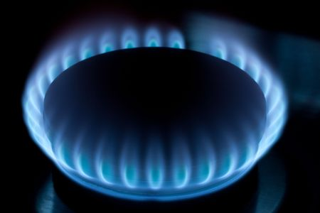 Natural gas burner. Blue flames burning steadily.  Stock Photo