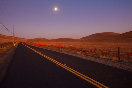 telephone pole: Romantic country road at dusk  Stock Photo
