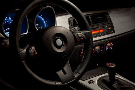 Sports car interior with dramatic night time lighting  Stock Photo