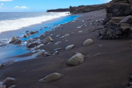 Volcanic rock based black sand beach