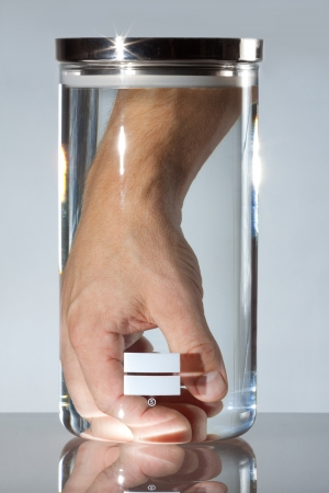 finger proof: Male hand and in medical or lab container; represents medical industry technology of the  Stock Photo
