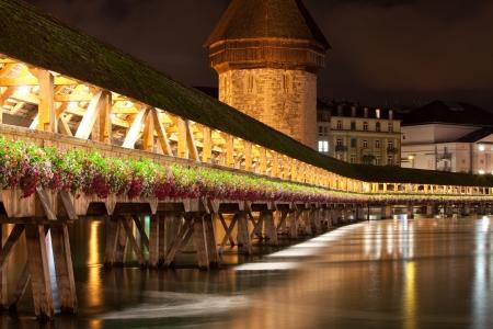 Historic Kapell bridge spanning a river (Reuss) in Lucerne Switzerland