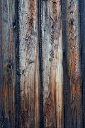 Rough textured wood plank fence.