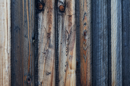 Close-up view of rough textured wood plank fence.  Stock Photo