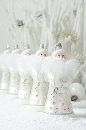 clauses: Santa Clauses in a row Stock Photo