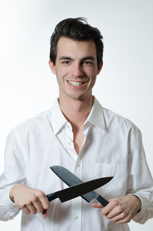 knifes: young man sharpens knifes Stock Photo