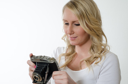 historic: young woman with historic camera Stock Photo