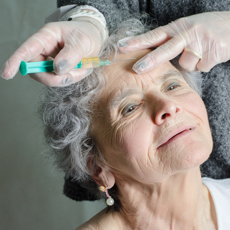 gets: old woman gets botox injection Stock Photo