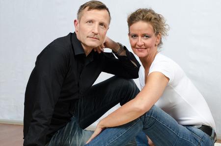 looking into camera: couple looking into camera