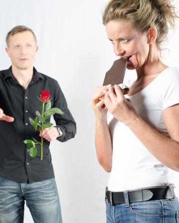 she: couple she eating chocolate Stock Photo