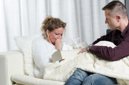 Couple on couch she is ill