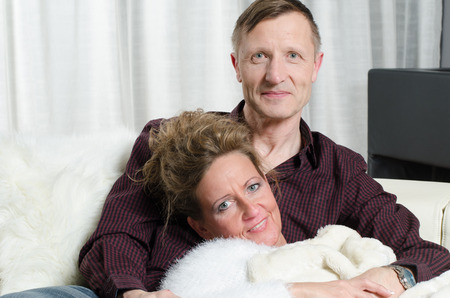 kanapa: couple on couch  she is ill