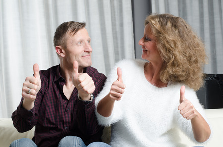 couple on couch: couple on couch thumbs up