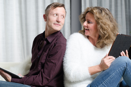 kanapa: couple looks at each other on couch