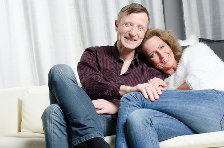 looking into camera: couple on couch looking into camera
