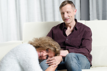couple on couch: couple talking on the couch Stock Photo