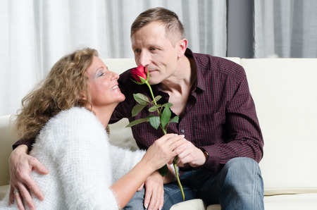 freetime: couple talking on the couch Stock Photo