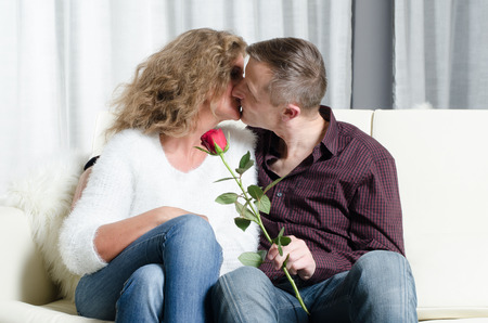 couple on couch: couple kissing on couch