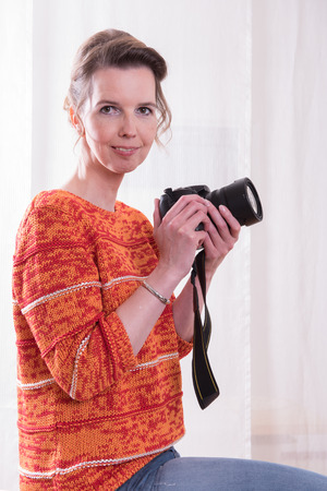 female photographer: female Photographer is ready to shoot