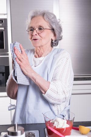 pensioner: female active pensioner is preparing strawberries