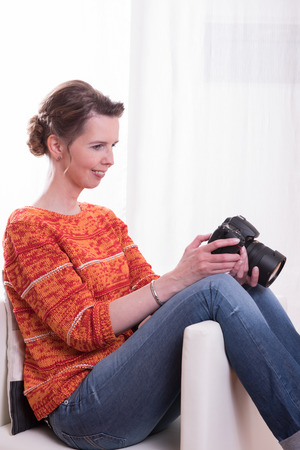 female photographer: female Photographer sitting in armchair Stock Photo